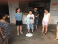 """广汉市人民医院到桔红村开展""""夏季送清凉活动"""""""